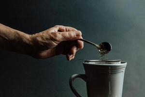 Preparing tea over a dark background photo