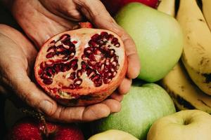 Old hands grabbing a passion fruit photo