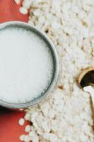 Oat seeds with a cup of oat milk photo