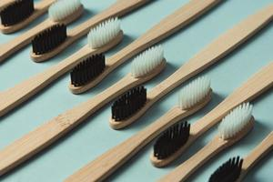 Minimalistic pattern of bamboo toothbrushes photo