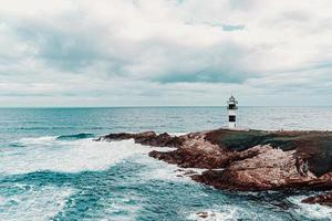 Lighthouse at the ocean photo