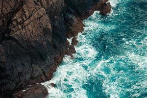 Water breaking on the rocks photo