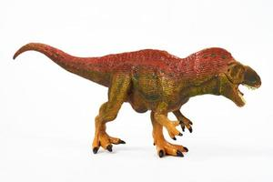Dinosaur rubber toy isolated on white photo