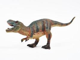 Tyrannosaur rubber toy isolated on white photo