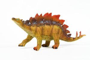 Juguete de goma de dinosaurio aislado en blanco foto
