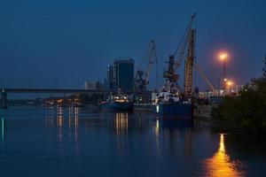 Evening dock view with ships and dockside cargo crane Astrakhan, Russia photo