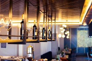 Restaurant wine bar with bottles and cosy light photo