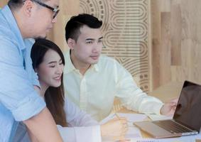 Asian businessmen are teaching jobs for new generations in office Teamwork concept photo