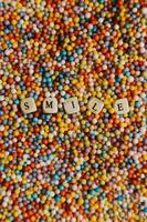 Colorful balls with Smile written on dices photo