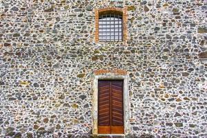 wooden door with lined window photo