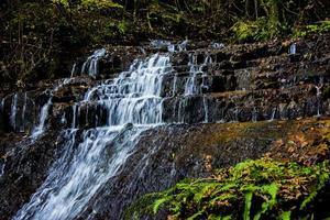 alpine waterfall in the autumn woods one photo