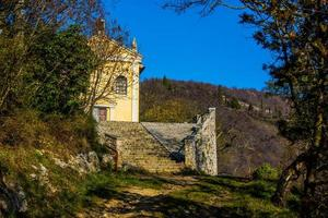 yellow church in the hills photo