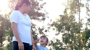 The little girl got angry at her mother while doing activities outdoors together in the summer garden video