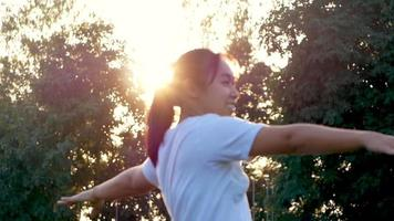 Portrait of beautiful young woman exercising in the park Healthy young woman warming up outdoors video
