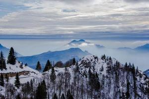 snow capped alpine peaks in the clouds one photo