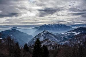alpine valleys with snow and fog photo