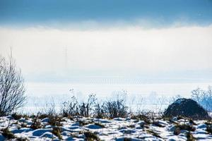 landscape between fog and snow photo