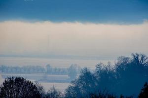 plain and fog in the snow one photo