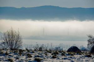 plain and fog in the snow photo
