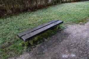 small wooden bench on towpath photo