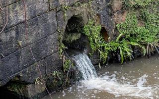Waterfall into Canal photo