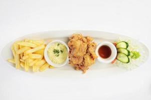 Deep Fried Chicken chicharr n de pollo  Fried chicken nuggets French fries and vegetables with chili sauce photo