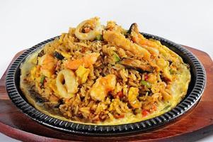 PERUVIAN FOOD sea food and rice called arroz con mariscos photo
