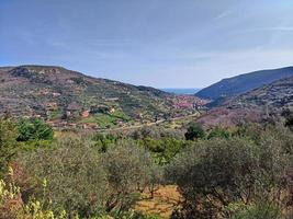Finale Ligure, coastal landscape with fields and mountains photo