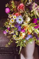 Vase of flowers used for a wedding ceremony photo