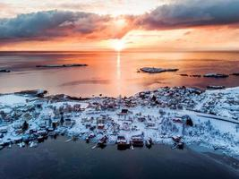 Aerial view of fishing village on seashore in winter at sunrise morning photo