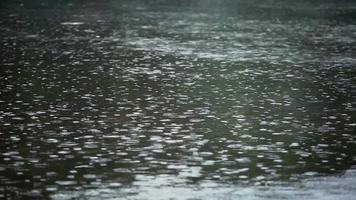 drizzle rain over warm water cold autumn evening video