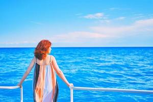 Behind girl on pier with ocean background photo