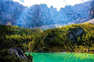 Lake Sorapis surrounded by the Ampezzo Dolomites photo