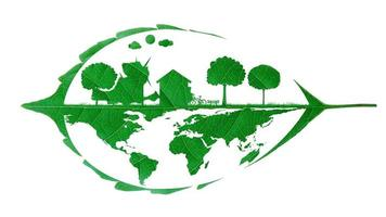 Real green leaf cutout with the shape of a house, wind turbines, and solar cell clean energy, and trees around. video