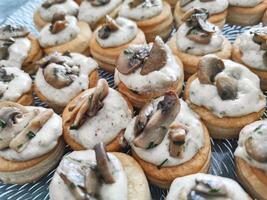 Fresh mushroom cream and puff pastry appetizer photo