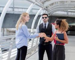 Young business people shake hands photo
