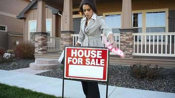 Realtor in front of a house video