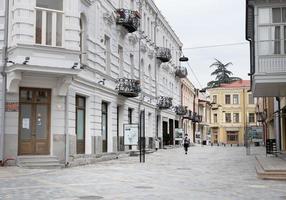 Tbilisi, Georgia 2020- Atoneli street with one walking female wearing mask during pandemic photo