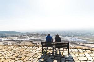 Couple sitting on the bench in Pamukkale,Turkey photo