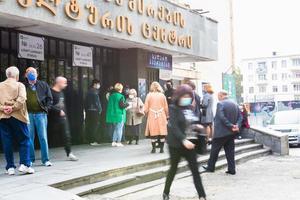 Tbilisi, Republic of Georgia 2020- Security checks citizen's ID's outside Labour Union Community Center Voting Station 26 in Saburtalo photo