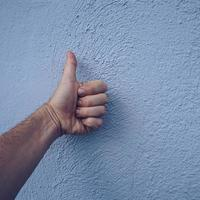 hand gesturing ok on the wall photo