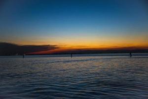 Sunset over the Venetian lagoon photo