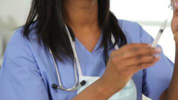 Doctor filling syringe video