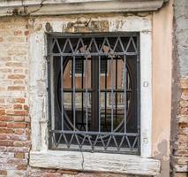 Metal grate on window photo