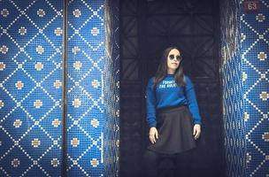 Tourist girl by blue wall photo