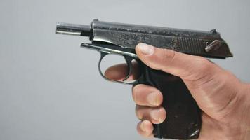 The gun in the hand clicks the shutter video