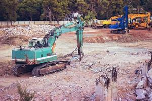 Big green excavator at construction site photo