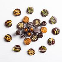 Chocolate pieces on the white background top view photo