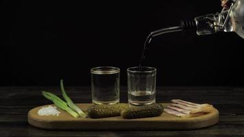 Vodka in a two foggy glass appetizer cucumber lard and green onion video