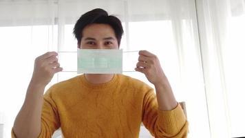 Asian man wearing a mask video